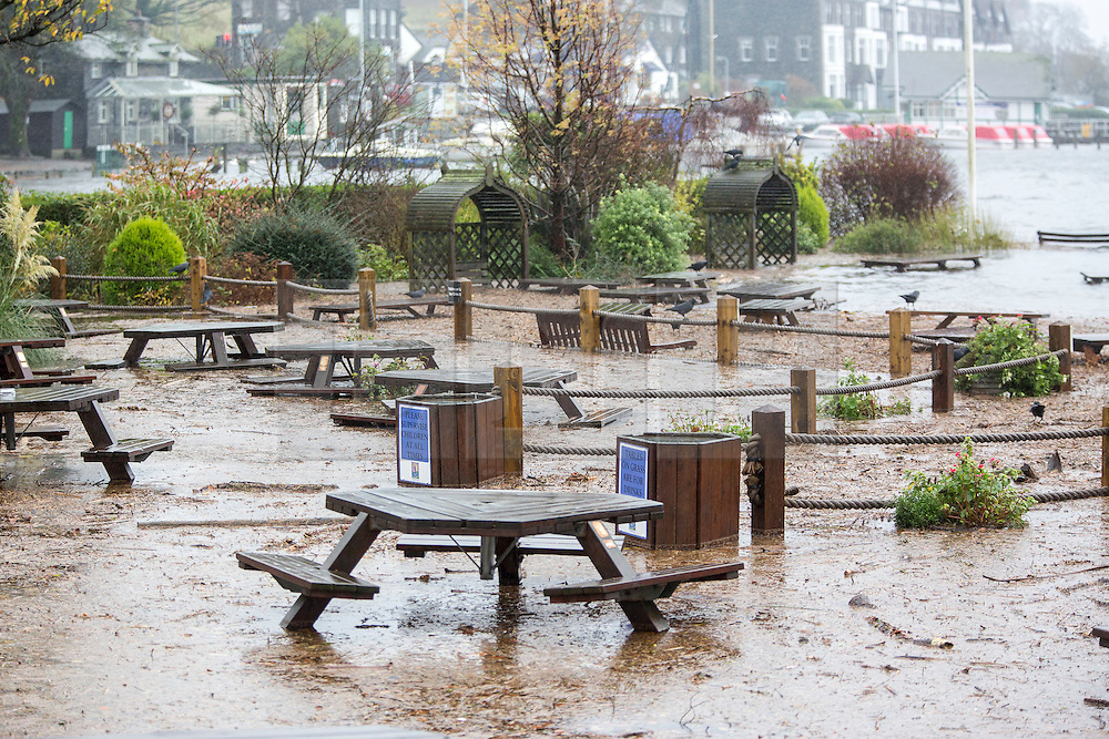 © Licensed to London News Pictures. 15/11/2015. Windermere UK. Picture shows the Flooded beer garden of the Wateredge Inn on the shore of Lake Windermere after last nights heavy rainfall, more rain is expected & the Environment agency have issued alerts for the area. Photo credit: Andrew McCaren/LNP