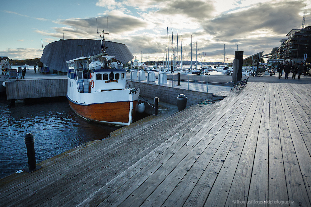 Oslo, Norway, October 2012: A small boat is moored at the wooden quayside.EDITORIAL ONLY: This Image is only for Editorial Use