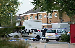 ©  London News Pictures. 15/10/2012. Harlow, UK. A burnt out car in front of a house (pictured right) on Barn Mead, Harlow, Essex where three children and a woman have died and three others are in hospital following a house fire. Two boys aged 13 and six, a girl aged 11 and the woman were declared dead at the scene. A nine-year-old boy and a three-year-old girl have serious burns and a man has minor burns. Photo credit : Ben Cawthra/LNP