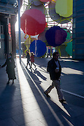 Pedestrians is urban cityscape architecture in a central London shopping precinct.