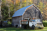 GMC truck by traditional and typical old barn in Vermont, New England, USA