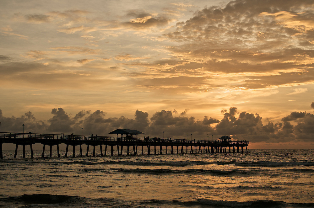 Sunrise in Lauderdale by the Sea Fishing Pier, in Fort Lauderdale, Florida.