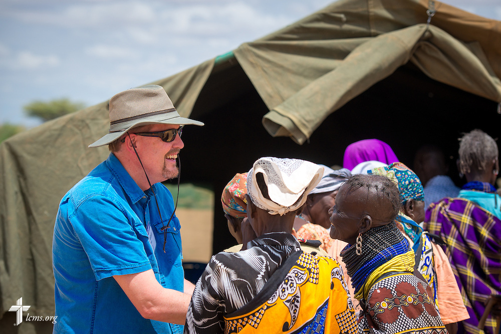The Rev. Robert Pase, pastor of Grace Lutheran Church, Midland, Texas, and Faith Lutheran Church, Andrews, Texas, greets patients during the LCMS Mercy Medical Team clinic on Monday, June 20, 2016, in Nataparkakono, a village in Turkana, Kenya.  LCMS Communications/Erik M. Lunsford