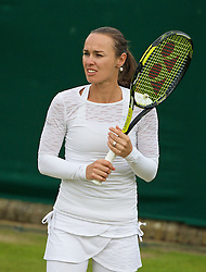 LONDON, ENGLAND - Wednesday, June 25, 2014: Martina Hingis (SUI) has to warm up without a cap after her own was ruled out by the umpire for breaching Wimbledon's strict brand guidelines during the Ladies' Doubles 1st Round match on day three of the Wimbledon Lawn Tennis Championships at the All England Lawn Tennis and Croquet Club. (Pic by David Rawcliffe/Propaganda)