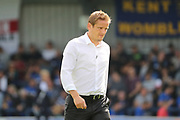 AFC Wimbledon manager Neal Ardley wsalking off the pitch during the EFL Sky Bet League 1 match between AFC Wimbledon and Shrewsbury Town at the Cherry Red Records Stadium, Kingston, England on 12 August 2017. Photo by Matthew Redman.