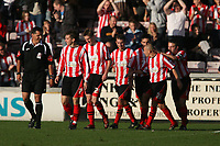 Photo: Pete Lorence.<br />Lincoln City v Rochdale United. Coca Cola League 2. 21/10/2006. <br />Lincoln City players celebrate Mark Stallard's second goal of the match.