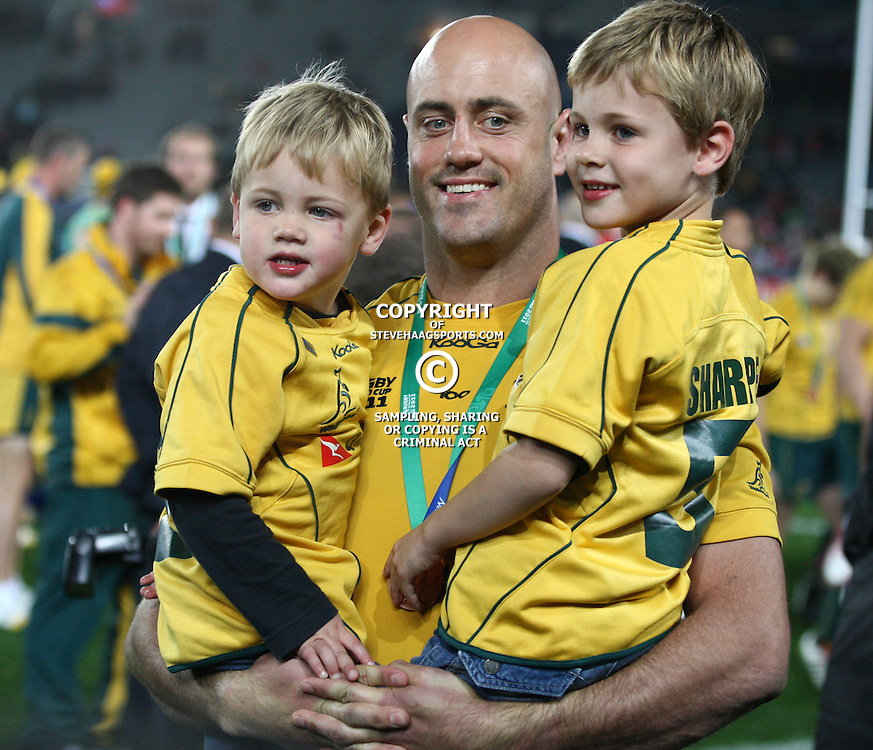 AUCKLAND, NEW ZEALAND - OCTOBER 21, Nathan Sharpe with his 2 boys during the 2011 IRB Rugby World Cup 3rd &amp; 4th playoff match between Australia and Wales at Eden Park on October 21, 2011 in Auckland, New Zealand<br /> Photo by Steve Haag / Gallo Images