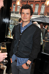 ORLANDO BLOOM at the launch of the Bremont Boutique, 29 South Audley Street, London on 17th July 2012.