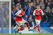 Chelsea midfielder Jorginho (5) shoves Arsenal forward Nicolas Pépé (19) to the ground during the Premier League match between Chelsea and Arsenal at Stamford Bridge, London, England on 21 January 2020.