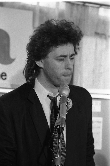 Bob Geldof Receives F.A.O.Medal..1986..16.10.1986..10.16.1986..16th October 1986..The highlight of Gorta's 21st anniversary World Food Day was the presentation of an F.A.O.(Food and Agriculture Organisation of the United Nations) to Bob Geldof. The medal was presented by An Taoiseach,Dr Garret Fitzgerald. The medal was in recognition of Bob's efforts and contribution towards famine relief in the Third World. The ceremony took place in The Berkeley Court Hotel in Dublin...After receiving his award Bob is pictured thanking the U.N.,but also speaking out about the scandal of millions of people dying around the world from starvation.
