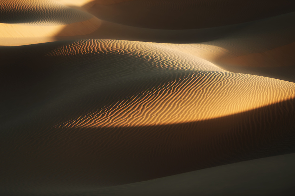 Desert sand dunes in Morocco. Strong sand pattern with deep shadows.
