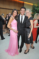 LIZ CUNDY,actor KEVIN SACRE and dancer CAMILLA DALLERUP at the annual Dog's Trust Honours Awards held at The Hurlingham Club, Fulham, London on 19th May 2009.