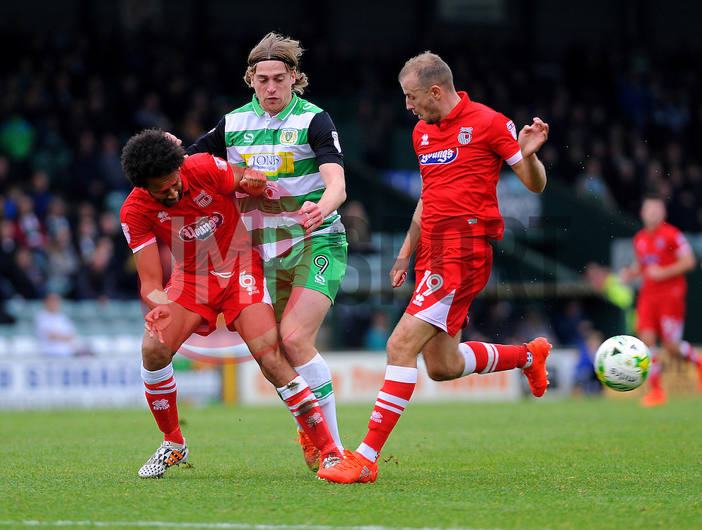 Joshua Gowling of Grimsby Town  tackles Tom Eaves of Yeovil Town  - Mandatory by-line: Nizaam Jones/JMP - 29/10/2016/ - FOOTBALL - Hush Park - Yeovil, England - Yeovil Town v Grimsby Town - Sky Bet League Two