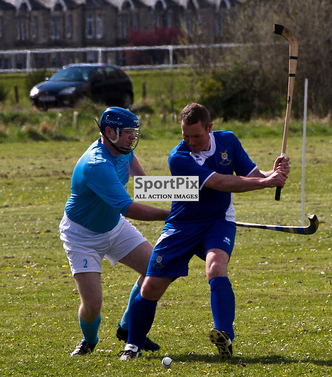 Hector MacKenzie clears from Malkie Morrison. The Army shinty team known as, SCOTS Camanachd played their first shinty game of the season when they took on Caberfeidh Camanachd from Strathpeffer at Levenhall Links, Musselburgh  21 April 2012