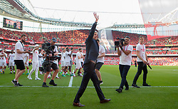 Arsenal manager Arsene Wenger salutes the fans after the final whistle