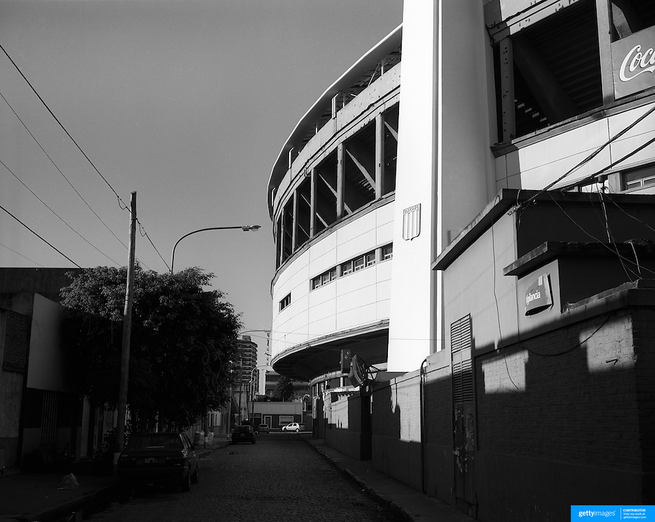 Playing with Ghosts... Football Stadiums of Argentina..Argentina, one of the powerhouses of World Football is steeped in history and tradition, so too are the countries stadiums. Many were built in the early part of the 1900's and maintain an incredible unique atmosphere of their own. Empty stadiums terraces sing to the observer, holding onto the fans voices from match days past when Argentina's fans show a passion for the game and their clubs which is second to none. The historic stadiums have a voice of their own and a unique atmosphere. ..The Estadio Presidente Juan Domingo Perón is a stadium located in Avellaneda, Argentina, a suburb of Buenos Aires. It is the home of Racing Club. The Stadium was opened September 3, 1950 having a capacity of more than 100,000 people but now parts of the ground are closed to spectators and it's capacity is now 51,389.