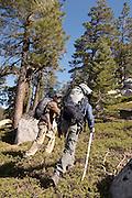 Hikers Climbing Hill