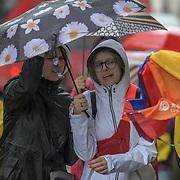 UK Weather:  Pedestrians holding umbrella in Rainy London, UK. 19 July 2019.
