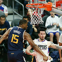15 April 2017: LA Clippers guard JJ Redick (4) passes the ball around Utah Jazz forward Derrick Favors (15) during the Utah Jazz 97-95 victory over the Los Angeles Clippers, during game 1 of the first round of the Western Conference playoffs, at the Staples Center, Los Angeles, California, USA.