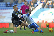 Mark Kitching challenges Jamie Walker during the EFL Sky Bet League 1 match between Wigan Athletic and Rochdale at the DW Stadium, Wigan, England on 24 February 2018. Picture by Daniel Youngs.