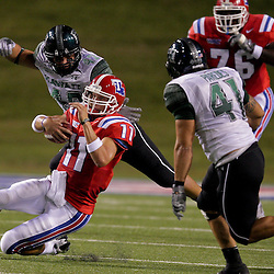 Sep 30, 2009; Ruston, LA, USA; Louisiana Tech Bulldogs quarterback Ross Jenkins (11) slides in front of Hawaii Warriors defenders Paipai Falemalu (42) and Corey Paredes (41) on a first half play at Joe Aillet Stadium. Mandatory Credit: Derick E. Hingle-US PRESSWIRE