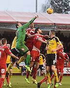 Lewis Price punches the ball clear under pressure from Sheffield United players during the Sky Bet League 1 match between Crawley Town and Sheffield Utd at Broadfield Stadium, Crawley, England on 28 February 2015. Photo by David Charbit.