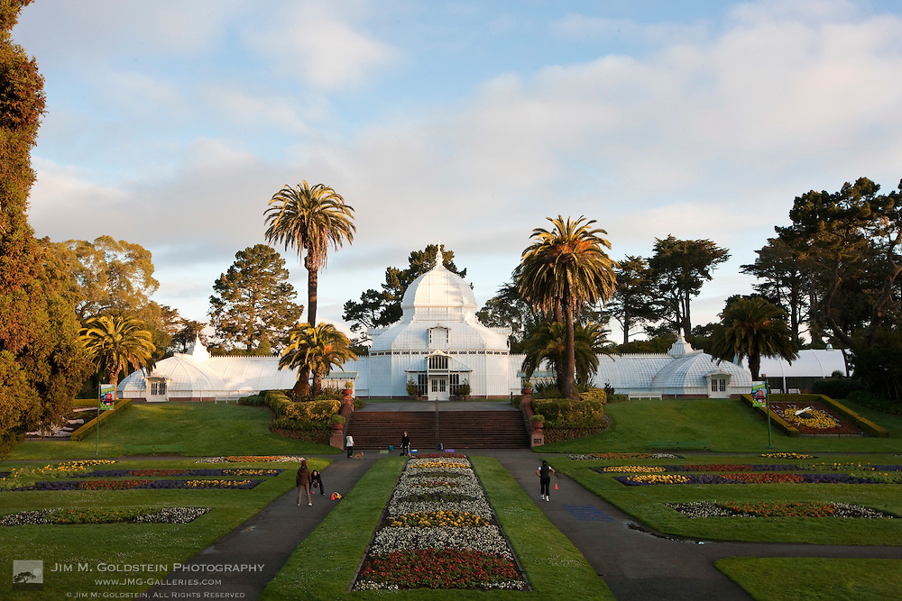 People exercise in front of the Conservatory of Flowers in San Francisco's Golden Gate Park in the early morning.