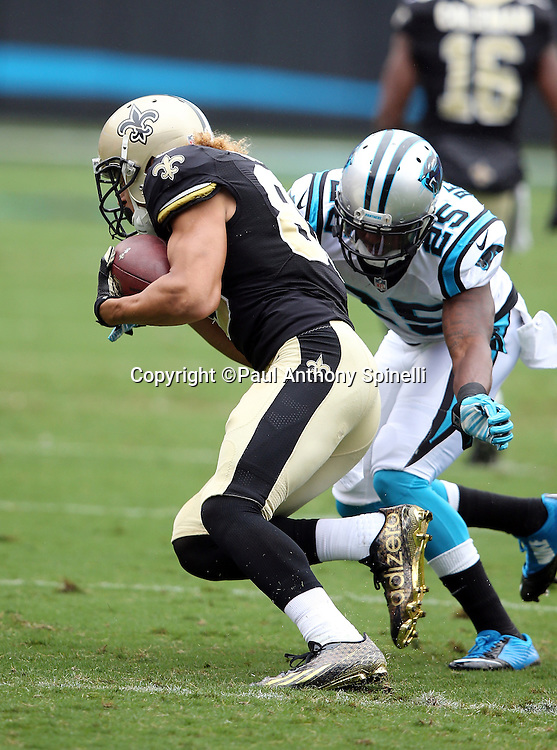New Orleans Saints wide receiver Willie Snead (83) gets tackled by Carolina Panthers cornerback Bene' Benwikere (25) as he catches a first quarter pass for a first down during the 2015 NFL week 3 regular season football game against the Carolina Panthers on Sunday, Sept. 27, 2015 in Charlotte, N.C. The Panthers won the game 27-22. (©Paul Anthony Spinelli)