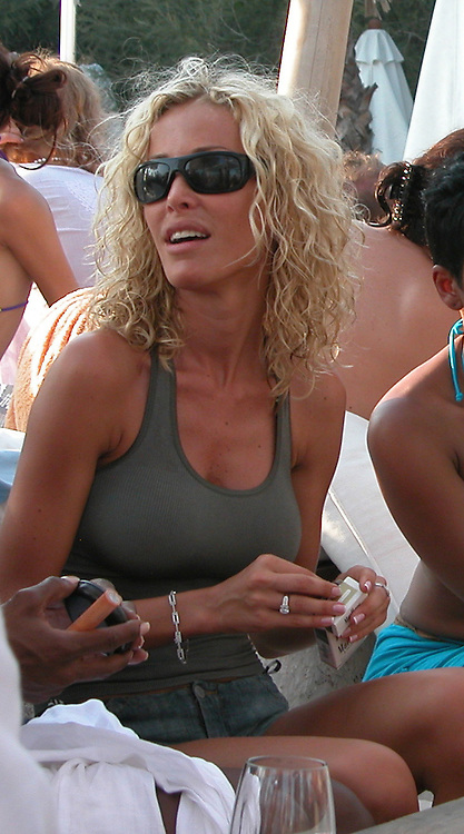 **EXCLUSIVE**.Ophelie Winter (French Actress & Singer) at Nikki Beach having drinks with friends.St. Tropez, France.Saturday, July 26, 2003.Photo By Celebrityvibe.com/Photovibe.com..