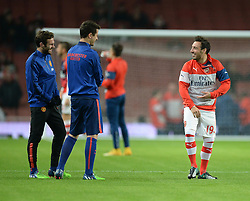 Arsenal's Santi Cazorla shares a joke in the warm up with Manchester United's Juan Mata - Photo mandatory by-line: Alex James/JMP - Mobile: 07966 386802 - 22/11/2014 - Sport - Football - London - Emirates Stadium - Arsenal v Manchester United - Barclays Premier League