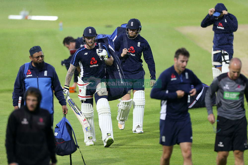 The England team take a break due to the rain during the training session at Edgbaston, Birmingham.