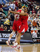 NC State's Marissa Kastanek (23) and Kody Burke (44) celebrate their 71 - 70 first round victory over Boston College in the 2011 ACC Women's Basketball Tournament held at the Greensboro Coluseum in Greensboro, North Carolina.  (Photo by Mark W. Sutton)