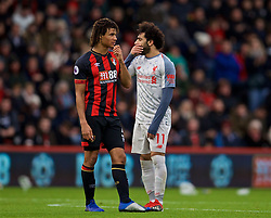 BOURNEMOUTH, ENGLAND - Saturday, December 8, 2018: AFC Bournemouth's Nathan Ake and Liverpool's Mohamed Salah during the FA Premier League match between AFC Bournemouth and Liverpool FC at the Vitality Stadium. (Pic by David Rawcliffe/Propaganda)