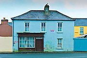 Graffiti on house with shop front for sale in Kilkee, County Clare, West of Ireland