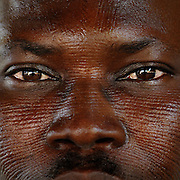 Benin, Natitingou April 20, 2005 - Man with tribal scarification on his face. Scarification is used as a form of initiation into adulthood, beauty and a sign of a village, tribe, and clan.