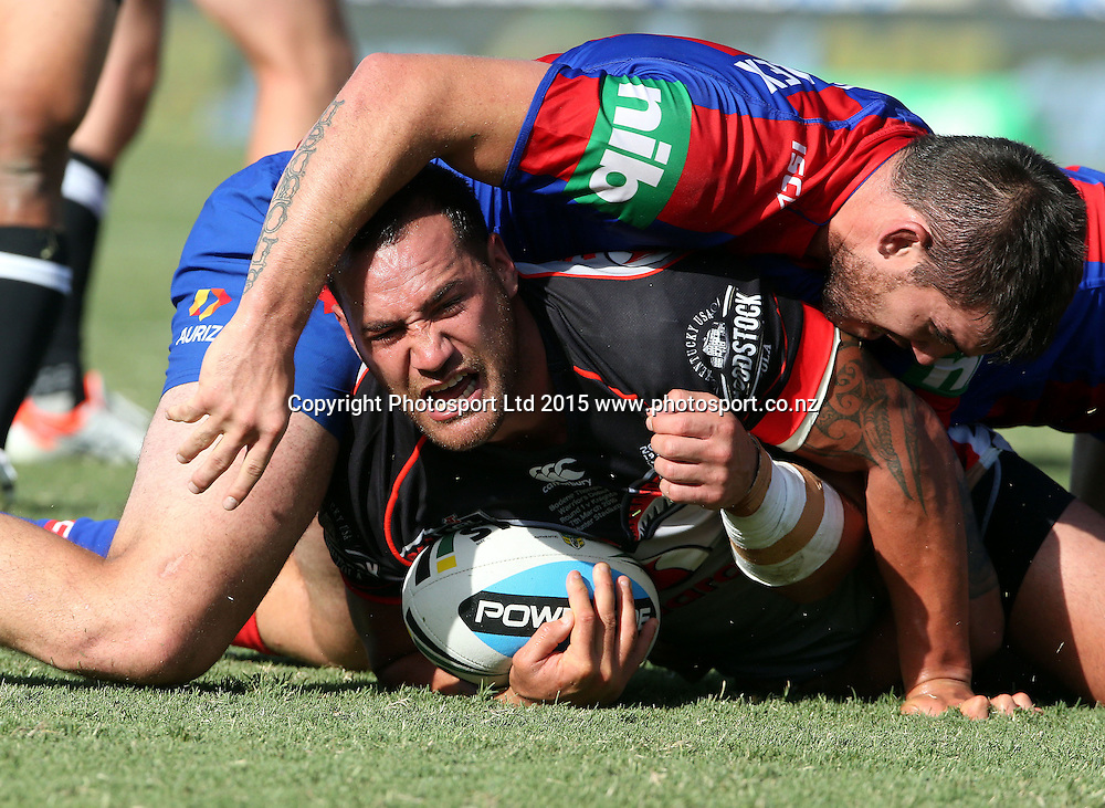 Bodene Thompson tackled by Kade Snowden<br /> Knights v Warriors NRL rugby league match at Hunter Stadium, Newcastle Australia. Saturday 7 March 2015. Photo: Paul Seiser/Photosport.co.nz