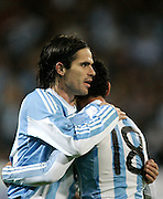 Argentina's Fernando Gago celebrates with Maxi Rodriguez  during the international friendly match between Spain and Argentina in Madrid, Spain on November 14 2009.