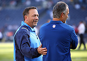 (L-R) San Diego Chargers defensive coordinator John Pagano talks to brother and Indianapolis Colts head coach Chuck Pagano before the NFL week 6 football game against the Indianapolis Colts on Monday, Oct. 14, 2013 in San Diego. The Chargers won the game 19-9. ©Paul Anthony Spinelli