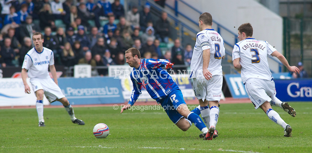 BRIGHTON, ENGLAND - Saturday, March 12, 2011: Tranmere Rovers' John Welsh trips Brighton & Hove Albion's Glenn Murray for a free kick during the Football League One match at the Withdean Stadium. (Photo by Gareth Davies/Propaganda)