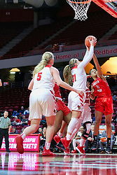 NORMAL, IL - December 04: Kayel Newland gets a loose ball over Nieja Crawford during a college women's basketball game between the ISU Redbirds  and the Austin Peay Governors on December 04 2018 at Redbird Arena in Normal, IL. (Photo by Alan Look)