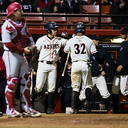 24 February 2018: The San Diego State Aztec baseball team competes in day two of the Tony Gwynn legacy tournament against #4 Arkansas. San Diego State Aztecs outfielder Chase Calabuig (34) congratulates teammate Denz'L Chapman (32) after tying the game at one in the bottom of the third inning. The Aztecs dropped a close game to the Razorbacks 4-2. <br /> More game action at sdsuaztecphotos.com