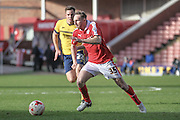 Aidan White (Barnsley) runs with the ball during the Sky Bet League 1 match between Barnsley and Scunthorpe United at Oakwell, Barnsley, England on 25 March 2016. Photo by Mark P Doherty.