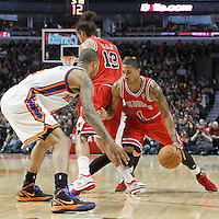 12 March 2012: Chicago Bulls point guard Derrick Rose (1) drives past New York Knicks point guard Jeremy Lin (17) on a screen set by Chicago Bulls center Joakim Noah (13) as New York Knicks center Tyson Chandler (6) steps up during the Chicago Bulls 104-99 victory over the New York Knicks at the United Center, Chicago, Illinois, USA.