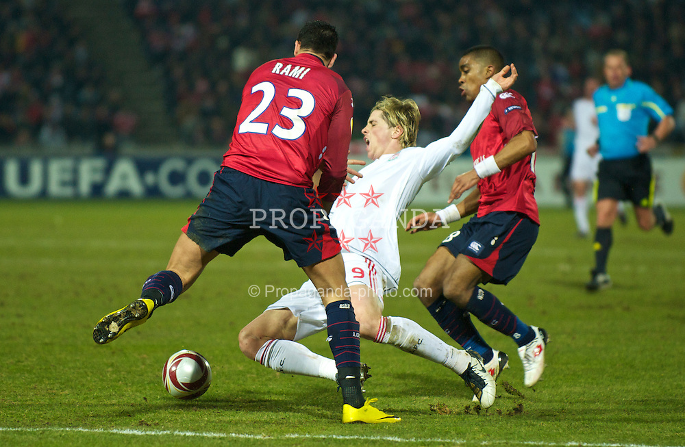 LILLE, FRANCE - Thursday, March 11, 2010: Liverpool's Fernando Torres is brought down by LOSC Lille Metropole's Franck Beria during the UEFA Europa League Round of 16 1st Leg match at the Stadium Lille-Metropole. (Photo by David Rawcliffe/Propaganda)