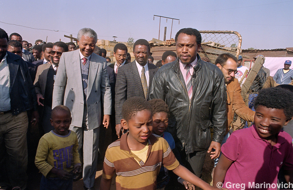 Phola Park, Thokoza, Transvaal, South Africa. Nelson Mandela and Tokyo Sexwale at Phola Park, the site of much violence between ANC, IFP and police and SADF. 1990/1