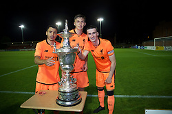 LEYLAND, ENGLAND - Friday, September 1, 2017: Liverpool's Paulo Alves, Nathaniel Phillips and captain Corey Whelan with the trophy after beating Fleetwood Town on penalties to win the Lancashire Senior Cup Final match between Fleetwood Town and Liverpool Under-23's at the County Ground. (Pic by Propaganda)