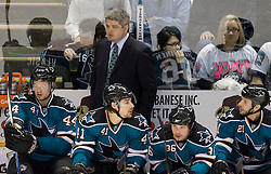 April 29, 2010; San Jose, CA, USA; San Jose Sharks head coach Todd McLellan (top) watches the game during the first period in game one of the western conference semifinals of the 2010 Stanley Cup Playoffs against the Detroit Red Wings at HP Pavilion.  San Jose defeated Detroit 4-3. Mandatory Credit: Jason O. Watson / US PRESSWIRE