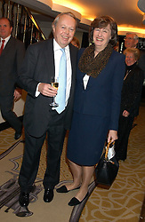 The EARL & COUNTESS DE LA WARR at The Sir Peter O'Sullevan Charitable Trust Lunch at The Savoy, London on 23rd November 2005.<br />