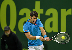 DOHA, Jan. 7, 2017  Novak Djokovic of Serbia returns to Fernando Verdasco of Spain during the men's singles semifinal of the ATP Qatar Open tennis tournament at the Khalifa International Tennis Complex in Doha, capital of Qatar, on Jan. 6, 2017. Novak Djokovic won 2-1. wll) (Credit Image: © Nikku/Xinhua via ZUMA Wire)