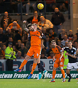 August 9th 2017, Dens Park, Dundee, Scotland; Scottish League Cup Second Round; Dundee versus Dundee United; Dundee's Jack Hendry and Dundee United's Mark Durnan battle in the air